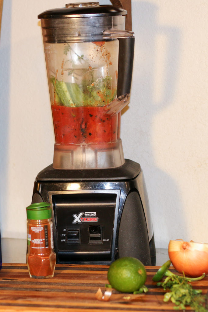 a blender with salsa in it