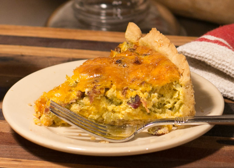 A slice of green chile bacon quiche